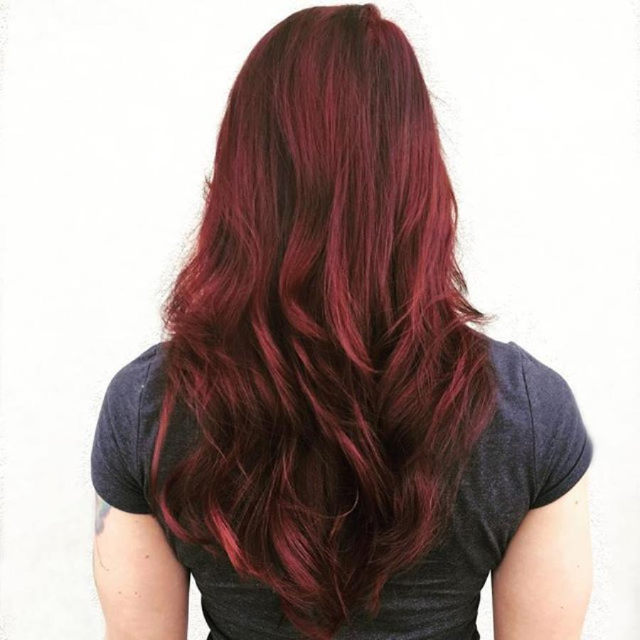 back of girls head showing long red hair