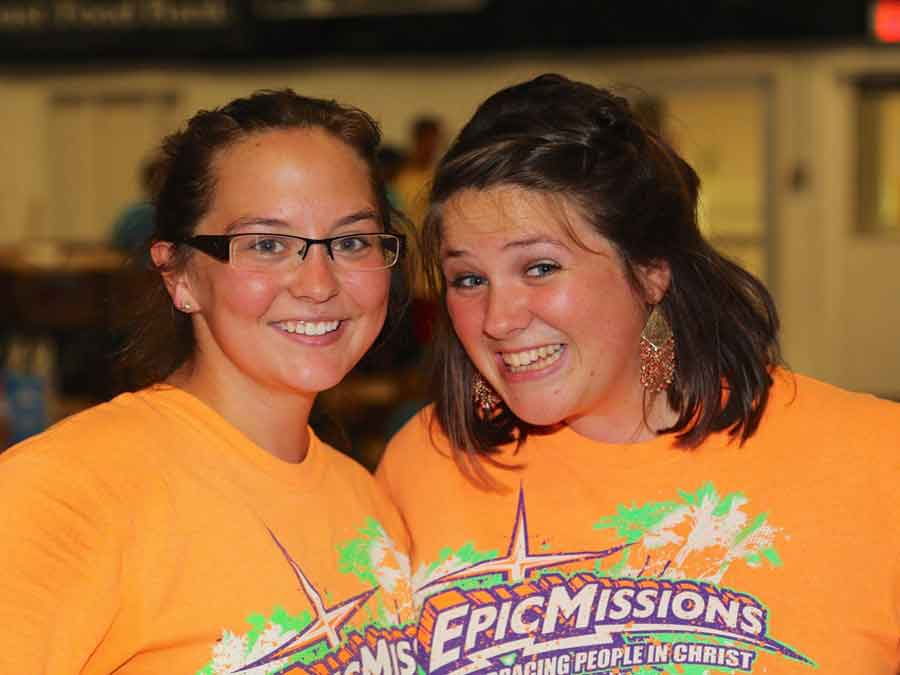 Two girls smiling with  Epic Mission T-shirts on