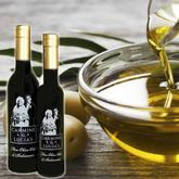 Fine Olive Oil bottles and bowl of olive oil