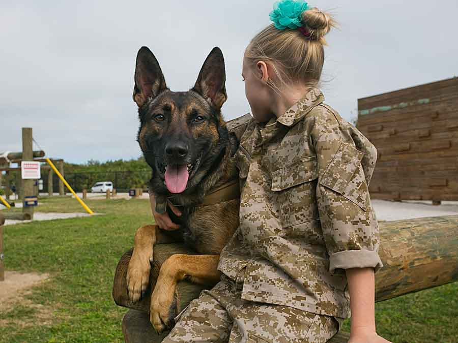 The National Navy UDT-SEAL Museum dog with girl