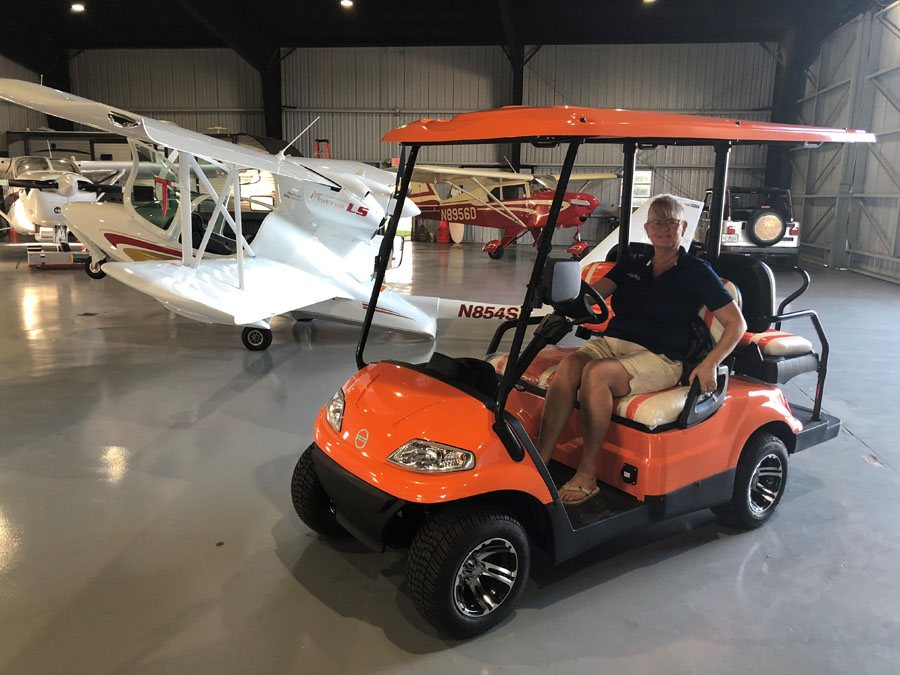 Orange  Golf Cart in airplane hanger