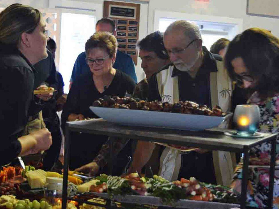 Guests getting food from buffet table