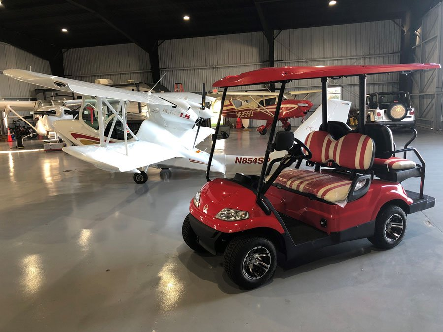 Red  Golf Cart in airplane hanger