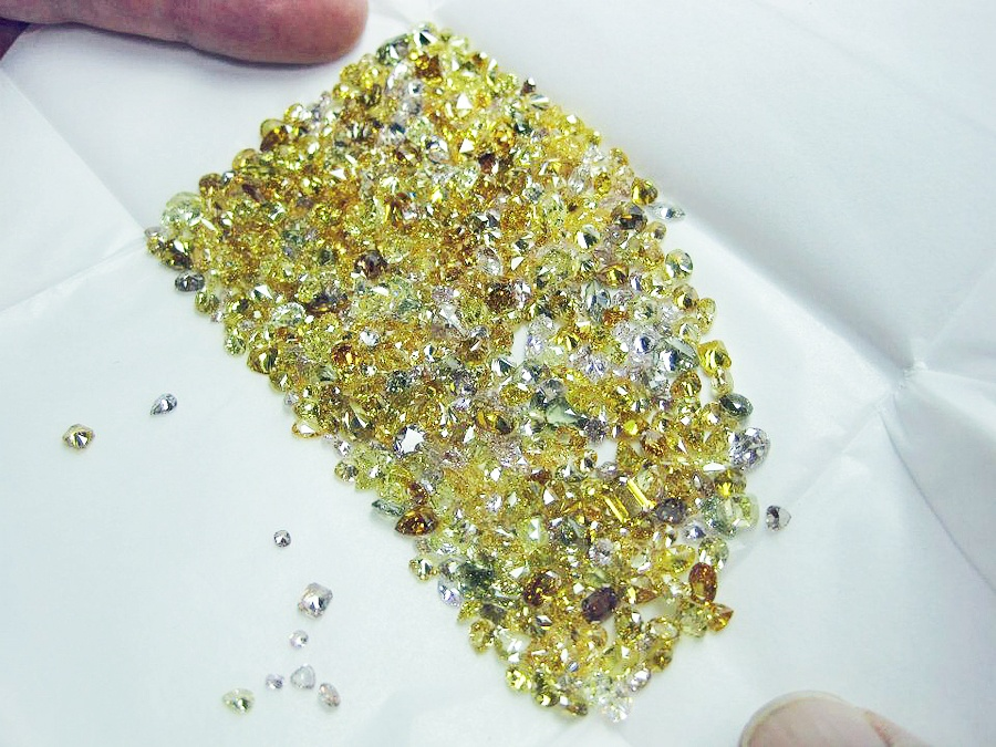John Michael Matthews inspecting a parcel of natural pistachio toned diamonds in Antwerp, Belgium