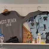 Men's T-shirt and shorts on display