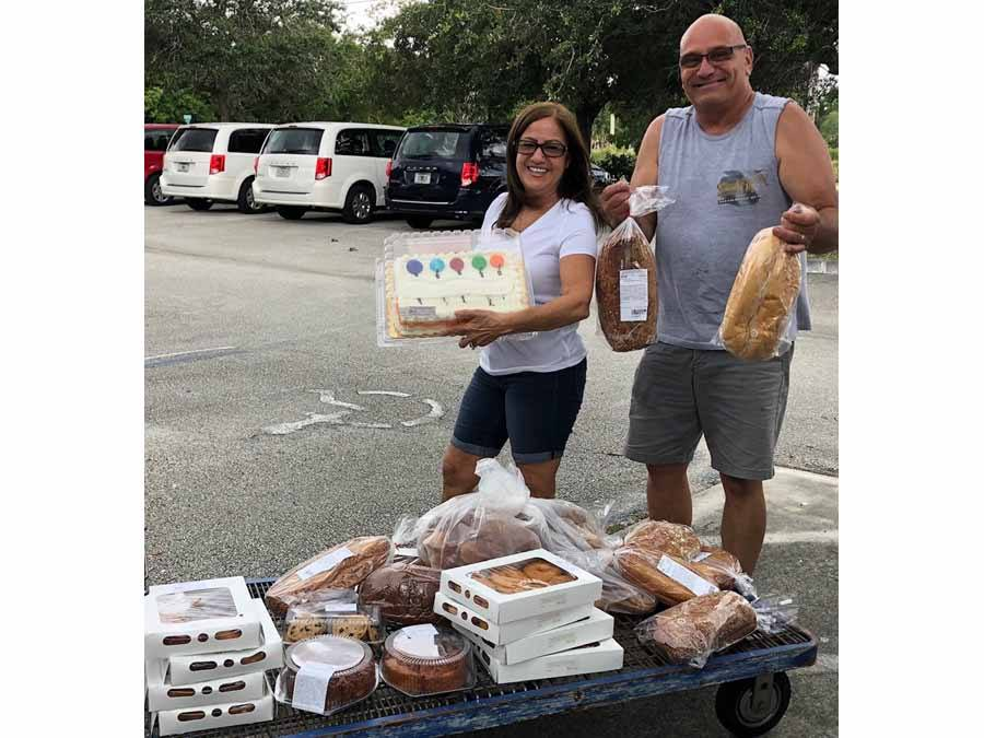 Man and Woman distributing baked goods