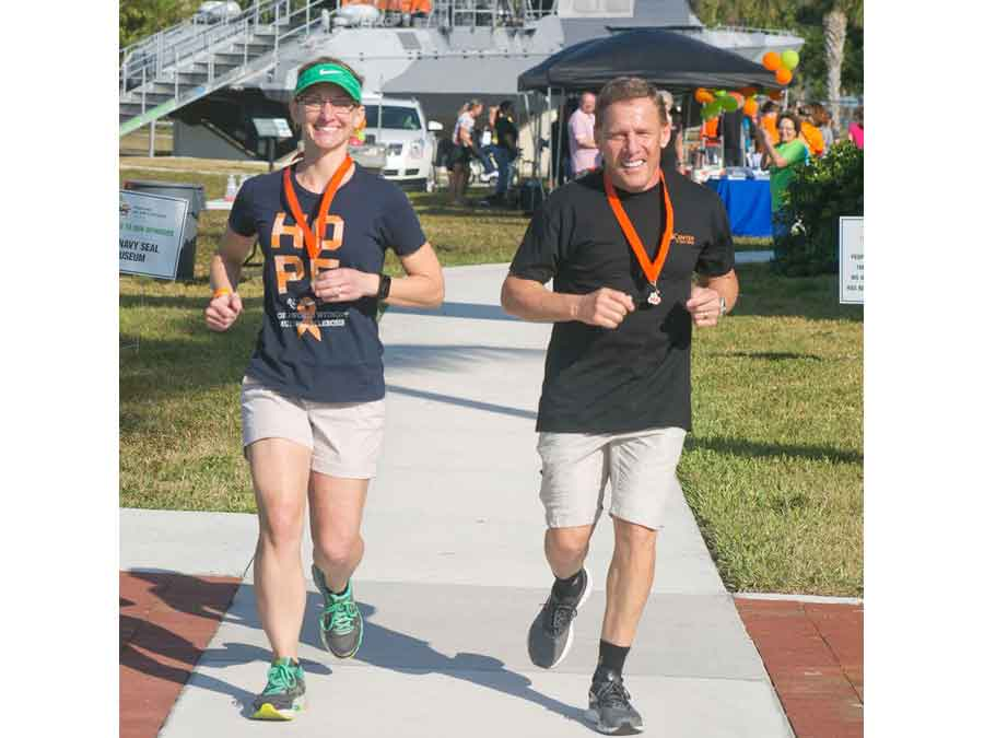 Two of the walkers jogging across the finish line