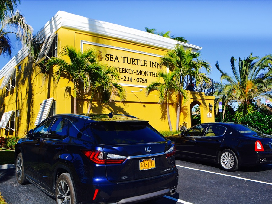 cars parked in front of Sea Turtle Inn