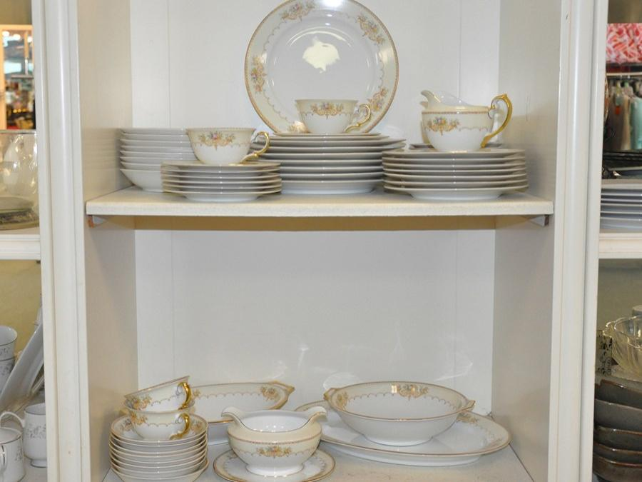 Dishes and cups on shelves for sale