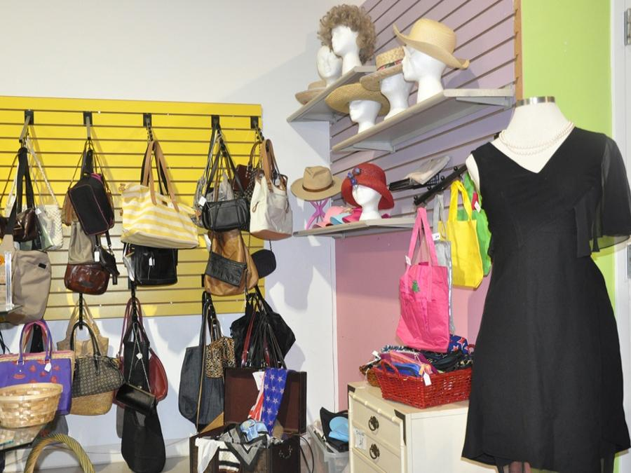 Women's dress and purses on display