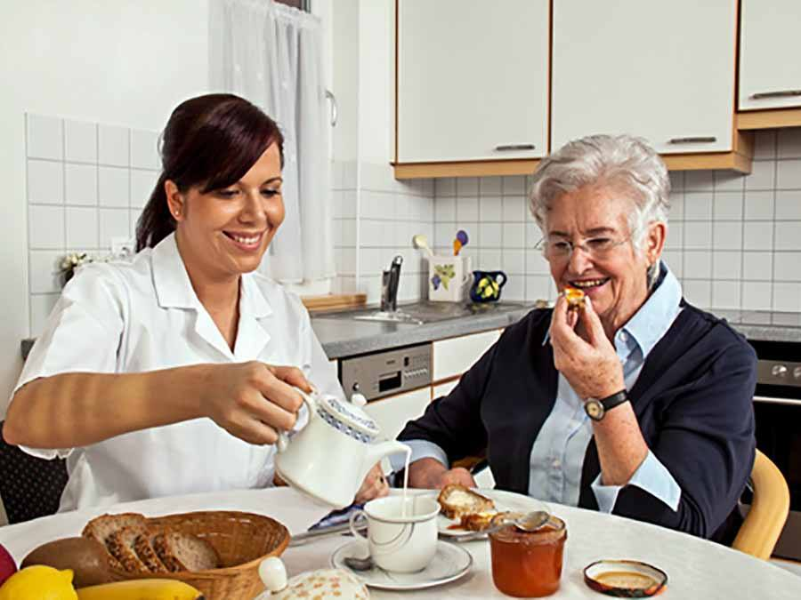 A Moments Notice Nurse having tea with patient