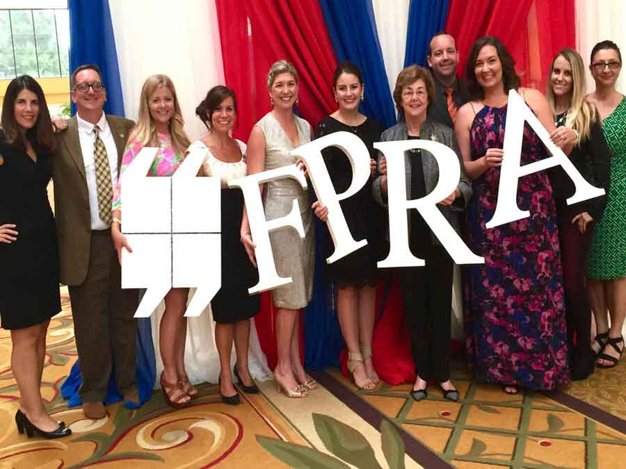 Florida Public Relations Association group photo holding up letters of logo