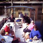 Family sitting on a Pontoon boat