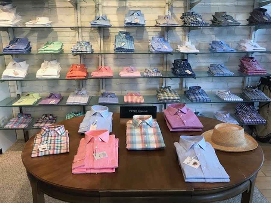 Dress shirts on table and shelves