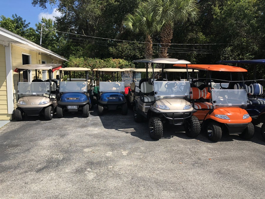 Golf Carts next to building