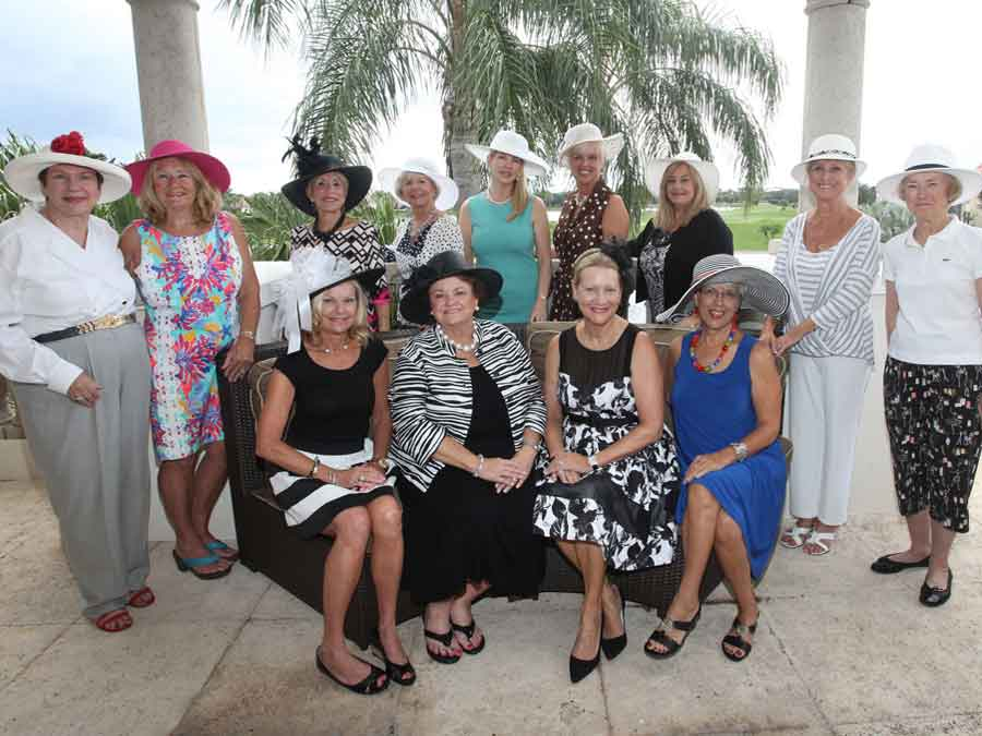 Photo of ladies wearing hats at fundraiser