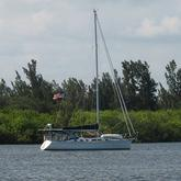 Large sailboat moored in river
