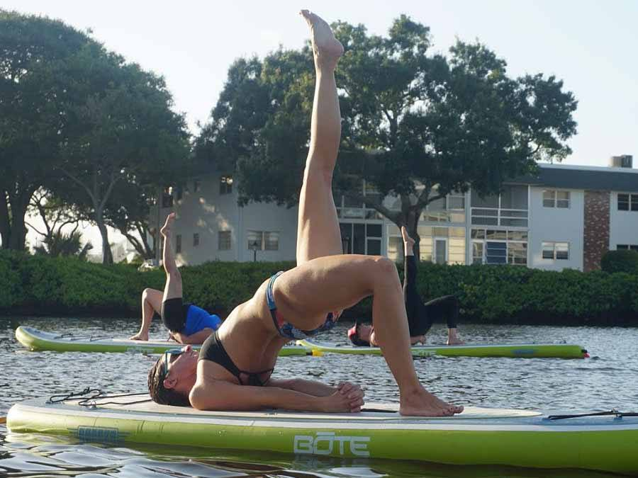 Woman doing yoga on SUP