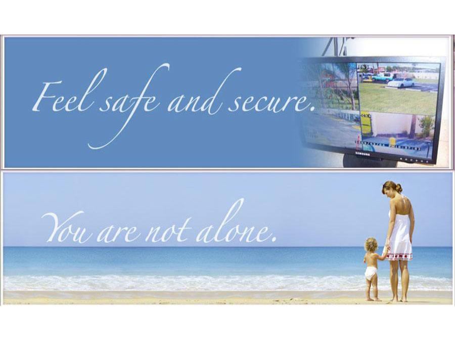 mother and child looking at ocean - caption - 'you are not alone' and 'feel safe and secure'