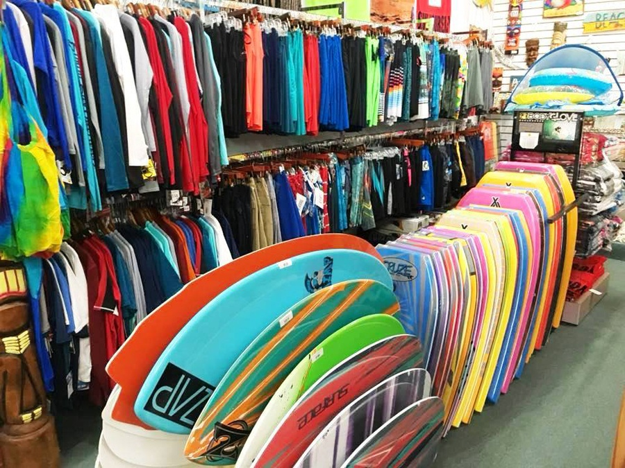 View of wet suites and skim boards for sale