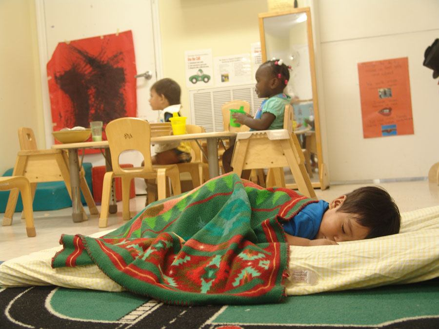 boy taking nap in classroom