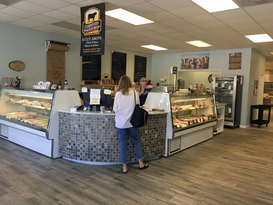 Customer checking out at register A Butcher Shoppe in Vero Beach