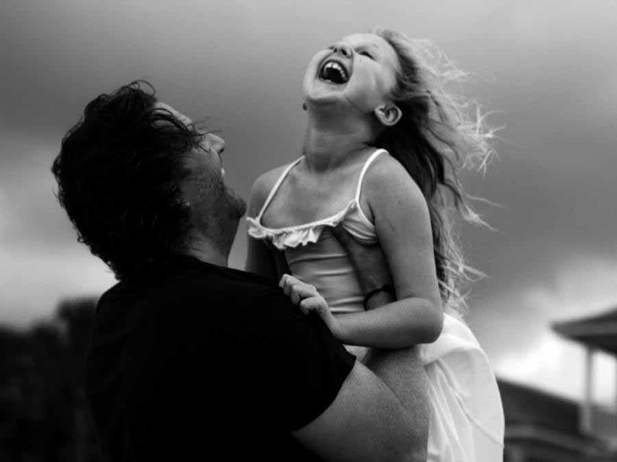 Man holding young girl in air