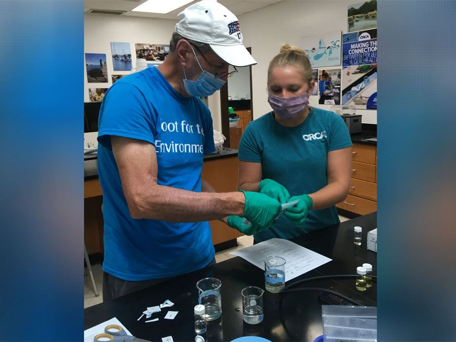 A man and a woman testing water samples at Citizen Science center in Vero Beach