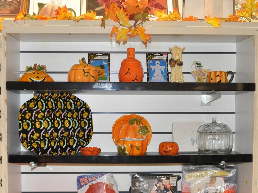 A display of Fall nick knacks on selves