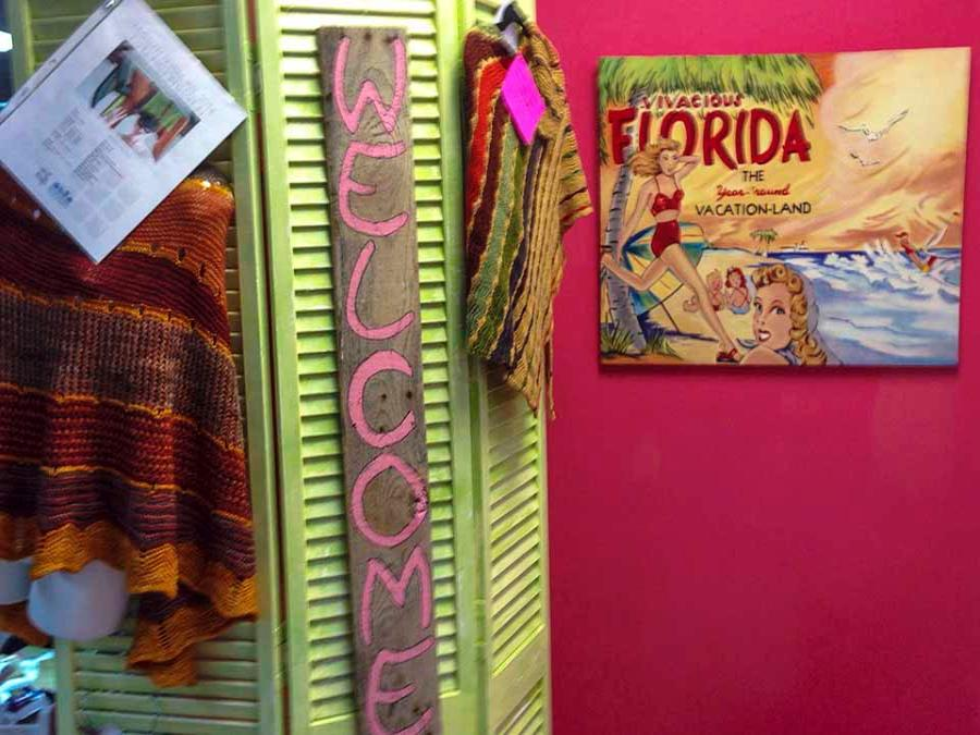 Old Florida poster and welcome sign inside shop