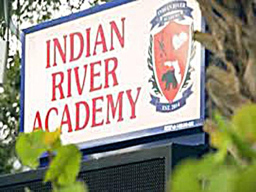 Indian River Academy sign at school