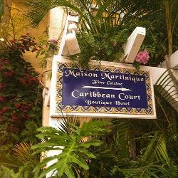 Sign to The Caribbean Court Boutique Hotel and Maison Martinique Restauarant in Vero Beach Florida