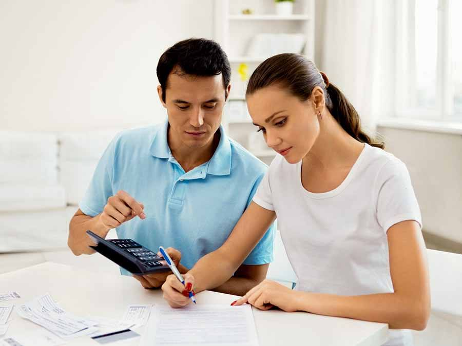 Couple working on finances with calculator