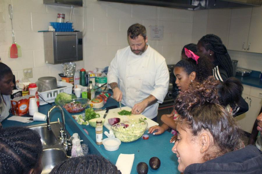 Chef Taylor Rye teaches GYAC students how to prepare a healthy meal.