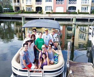 Family and friend heading out on a pontoon boat